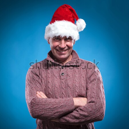 undecided young man in santa hat Stock photo © feedough