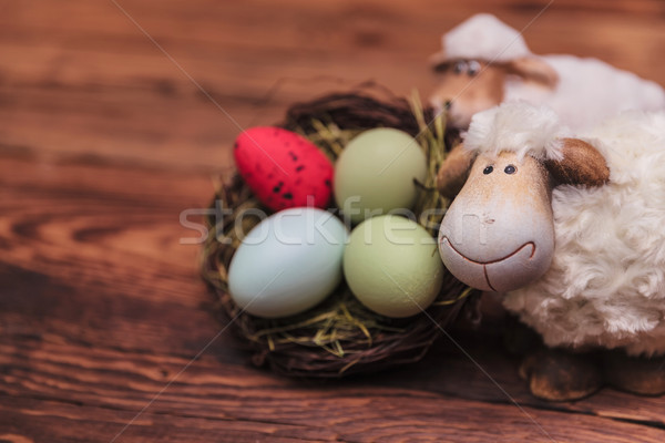 couple of easter sheeps near eggs basket Stock photo © feedough
