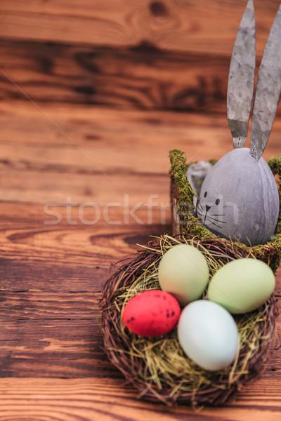Aranyos beton alkat húsvéti tojás kosár régi fa Stock fotó © feedough