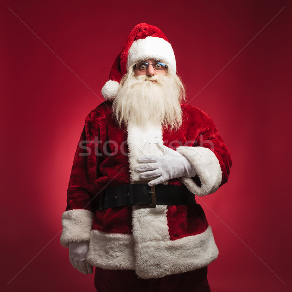 hungry santa claus with palm on his belly  Stock photo © feedough