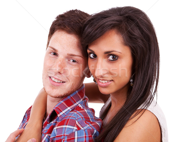 young woman holding her hand around her boyfriend's neck Stock photo © feedough