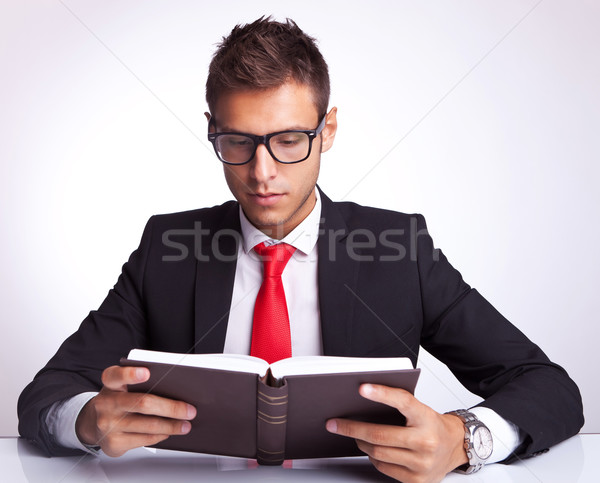 Stock photo: business man wearing glasses reading a book