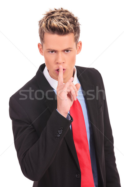 business man showing silence gesture  Stock photo © feedough