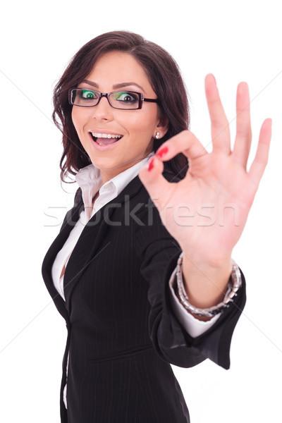 деловой женщины вызывать знак молодые улыбаясь Сток-фото © feedough