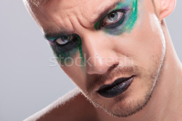 casual man with makeup looks at you Stock photo © feedough