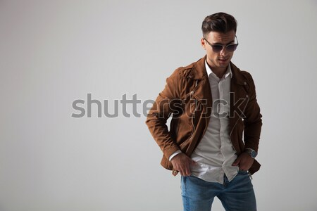 casual man looks at you with his jacket on his shoulder Stock photo © feedough