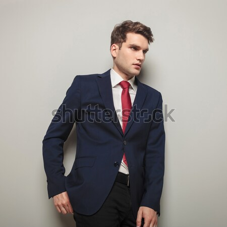 Side view of a business man leaning on a wall  Stock photo © feedough
