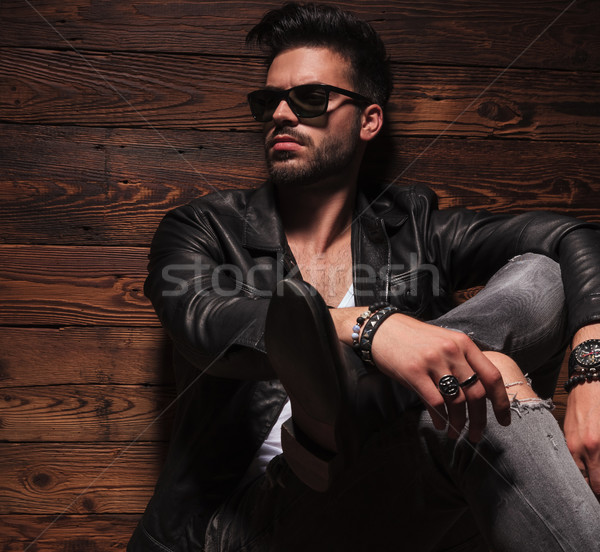 side picture of fashion man sitting with crossed legs Stock photo © feedough