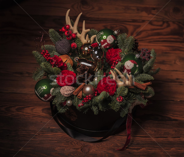 christmas arrangement with toy reindeer, horns, flowers  Stock photo © feedough