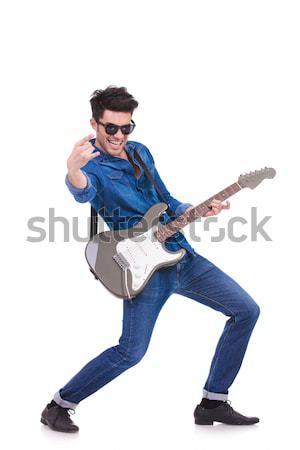 Namiętny gitarzysta rock toczyć znak ręką Zdjęcia stock © feedough