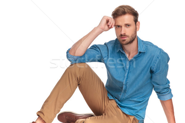 casual young man sitting on the floor and thinks  Stock photo © feedough