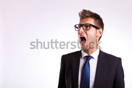 young business man or student screaming Stock photo © feedough