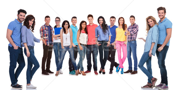 young casual people inviting you to join their team Stock photo © feedough