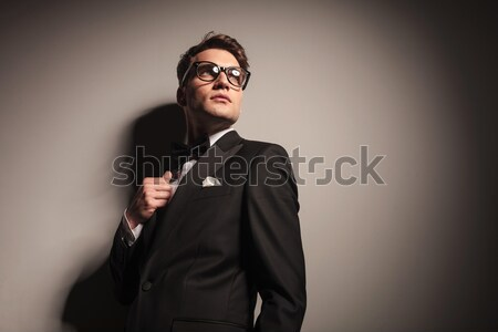 smiling business man fixing his tie. Stock photo © feedough
