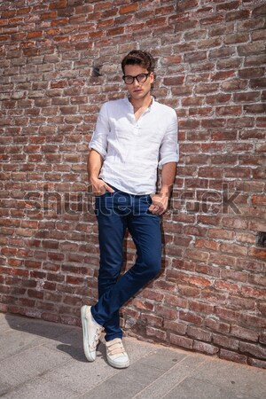 business man standing while holding a leg on a  box Stock photo © feedough