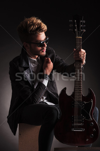 guitarist holding his electric guitar and collar Stock photo © feedough