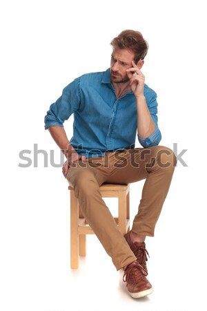 Sitzend Mann Scharfeinstellung etwas Finger Stock foto © feedough