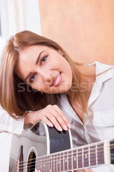 улыбаясь девушки гитаре Cute черный Сток-фото © feelphotoart