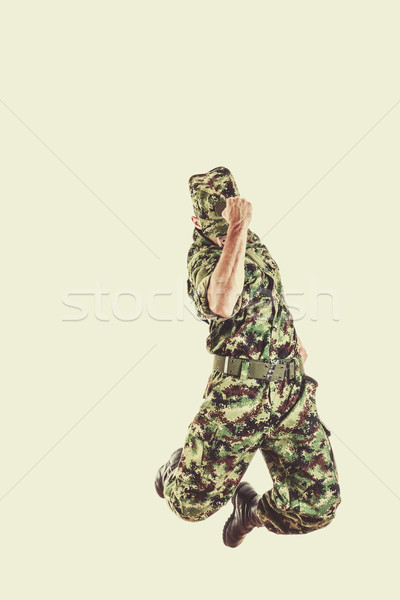 soldier with hidden face in green camouflage uniform jumping Stock photo © feelphotoart