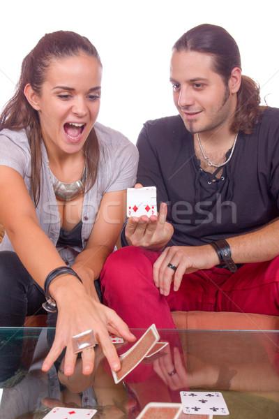 Férfi mutat kártya trükk nő asztal Stock fotó © feelphotoart
