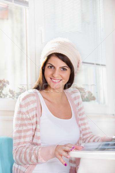 Lány ablak mosolyog tart magazin csinos Stock fotó © feelphotoart