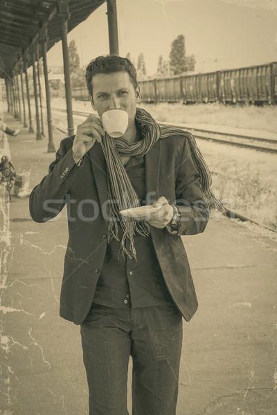 Jóképű férfi modell iszik kávé vasútállomás fiatal Stock fotó © feelphotoart
