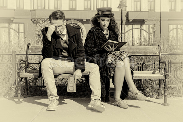 Young couple in quarrel sitting on bench in old town Stock photo © feelphotoart