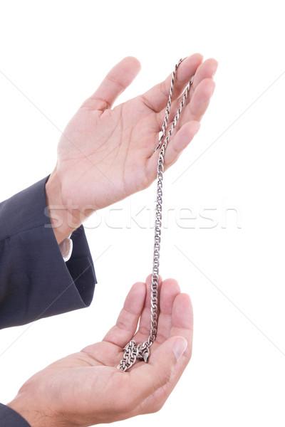 Férfi kezek tart ezüst nyaklánc izolált Stock fotó © feelphotoart