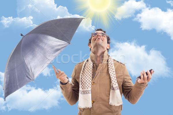 человека пальто зонтик солнце взрослый телефон Сток-фото © feelphotoart