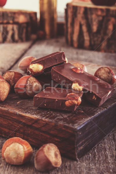 cubes of chocolate with hazelnuts or nuts around  on  wooden pie Stock photo © feelphotoart