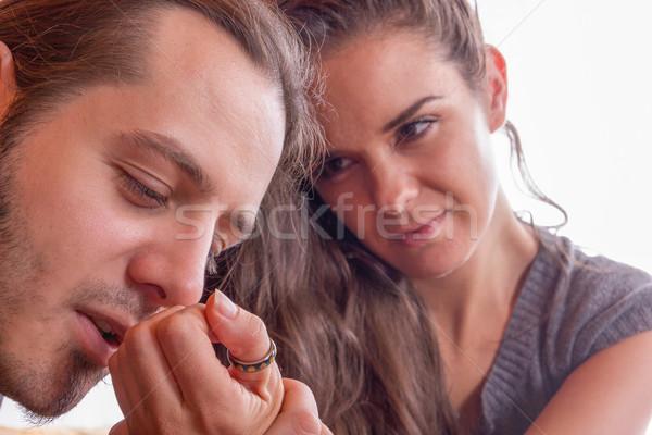 man kisses hand of his girlfriend Stock photo © feelphotoart
