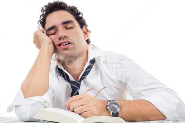sleepy man with glasses in white shirt and tie sitting with book Stock photo © feelphotoart