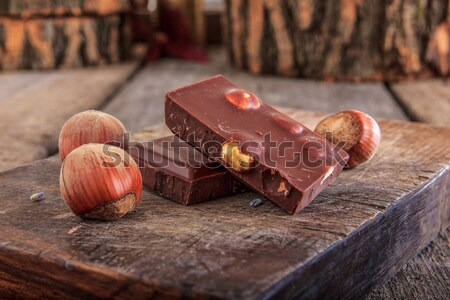 Chocolate and nuts on stump of wood from top view Stock photo © feelphotoart