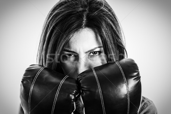 Stock photo:  fearless and furious modern business woman with boxing gloves