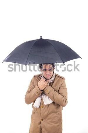 man in the coat with umbrella freezes Stock photo © feelphotoart