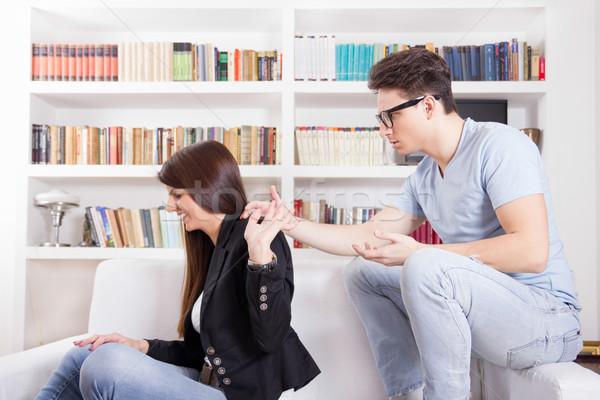 Pár konfliktus veszekedik otthon kéz a kézben kanapé Stock fotó © feelphotoart