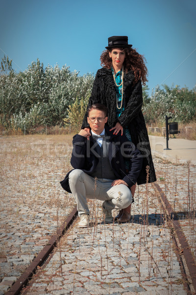 Retro fashionable woman and man standing on railroad in vintage Stock photo © feelphotoart
