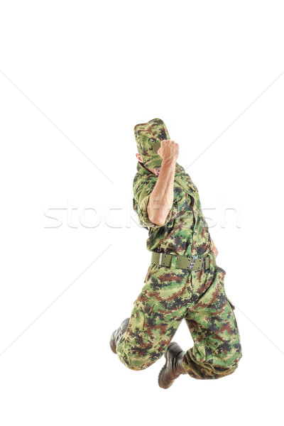 soldier with hidden face in green camouflage uniform and hat jum Stock photo © feelphotoart