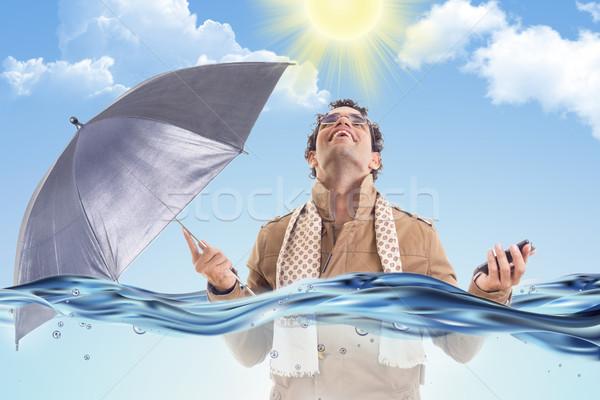 человека пальто воды зонтик взрослый Сток-фото © feelphotoart