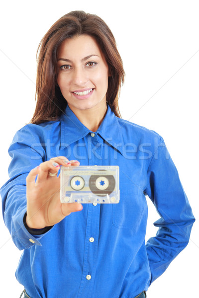 Beautiful smiling woman with audio cassette in her hand Stock photo © feelphotoart