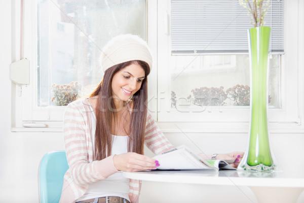 girl reading by the window Stock photo © feelphotoart