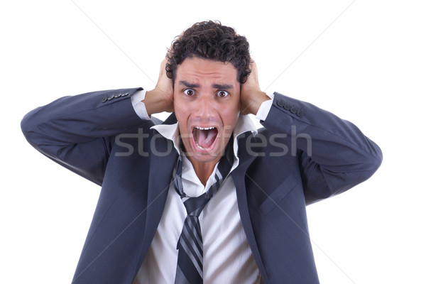 man in suit holding his head and screaming Stock photo © feelphotoart