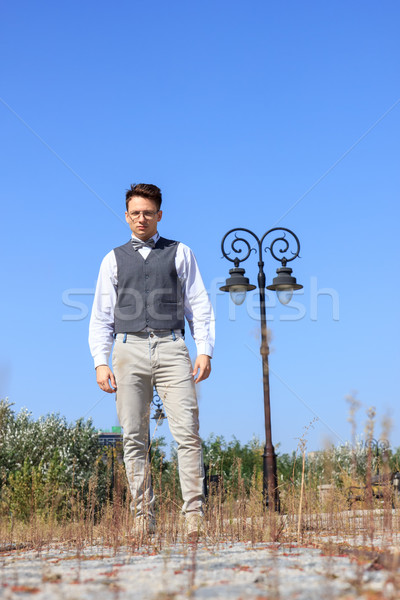 man in shirt and vest with bow tie and glasses standing Stock photo © feelphotoart