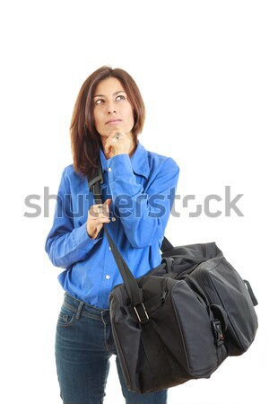 Pensive woman daydreaming going on vacation with travel bag Stock photo © feelphotoart