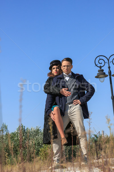 Fashionable vintage couple standing outside in romantic style Stock photo © feelphotoart