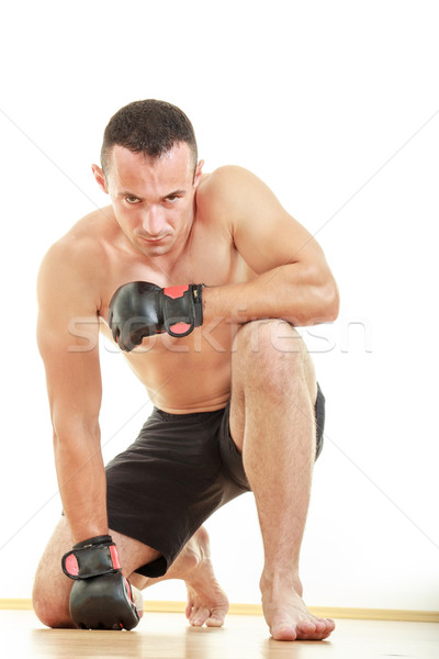angry martial fighter with fight gloves pray for victory while k Stock photo © feelphotoart