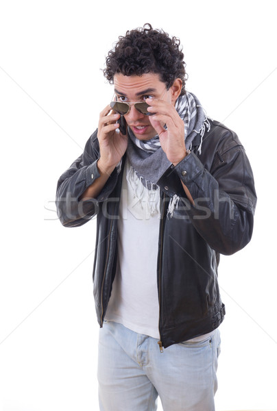 good looking man in a leather jacket talking over phone Stock photo © feelphotoart