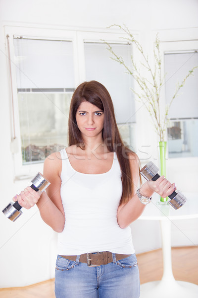 pretty sad girl exercise with weights Stock photo © feelphotoart