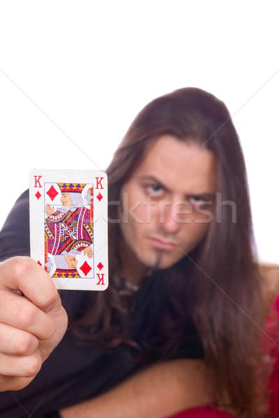 man shows the king of spades Stock photo © feelphotoart