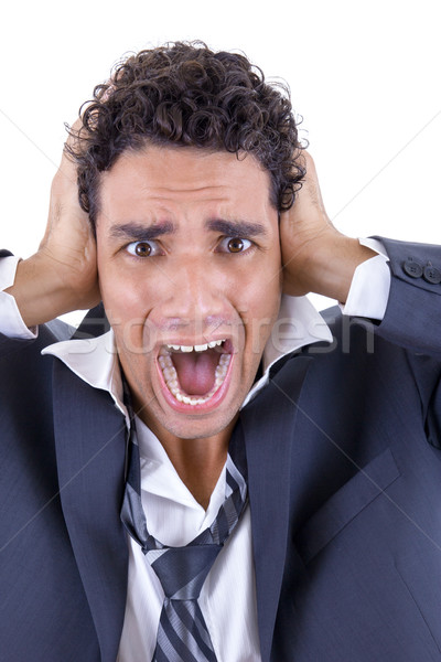 adult man in suit holding his head and screaming Stock photo © feelphotoart